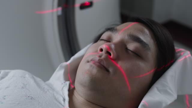 cu patient being prepared for medical scan / payson, utah, usa - ペイソン点の映像素材/bロール