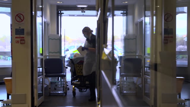patient brought into accident and emergency department at nhs university hospital in wishaw, lanarkshire, during the coronavirus pandemic - casualty stock videos & royalty-free footage