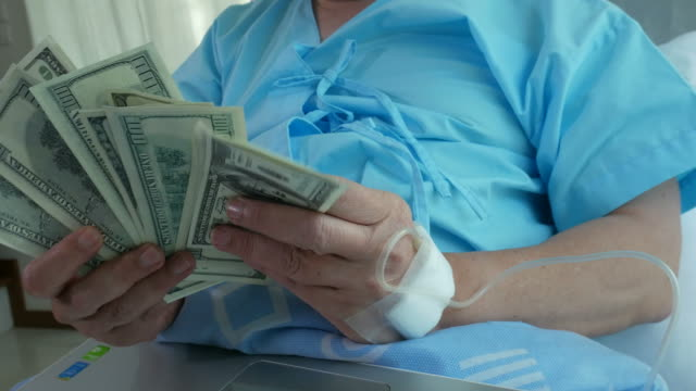 patient businessman counting cash money on bed - assistive technology stock videos & royalty-free footage