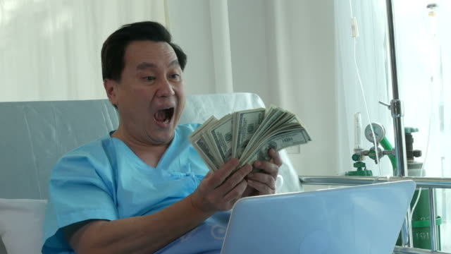 patient businessman counting cash money on bed - fee stock videos and b-roll footage