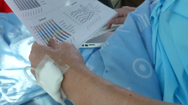 patient businessman sit on bed , checking paper data - tecnologia assistiva video stock e b–roll