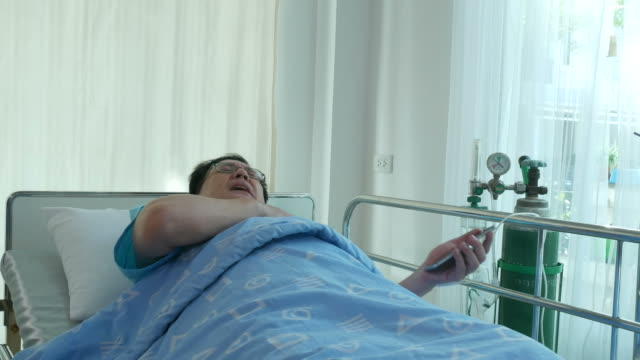 patient businessman sit on bed , using phone , heart attack