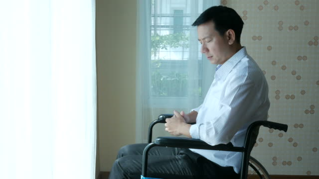 patient businessman sit on wheelchair , feel depressed - accessibility stock videos & royalty-free footage