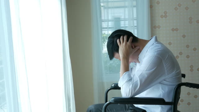 patient businessman sit on wheelchair , feel depressed