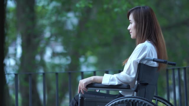 patient businesswoman sit on wheelchair , feel depressed - paralysis stock videos & royalty-free footage