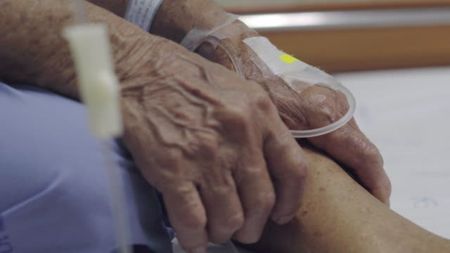 patient care - saline drip stock videos and b-roll footage
