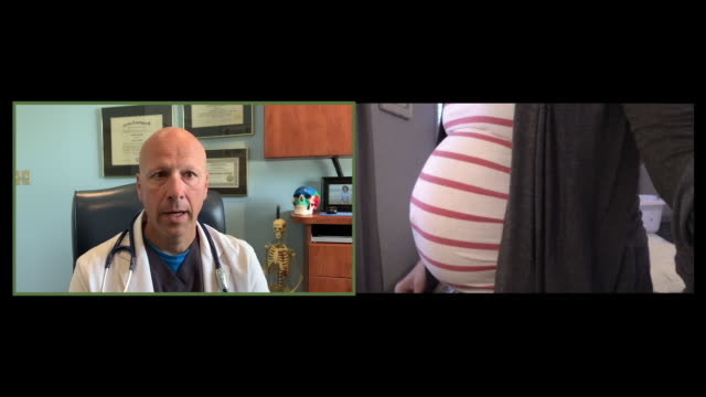 patient discusses pregnancy with doctor - prenatal care stock videos & royalty-free footage