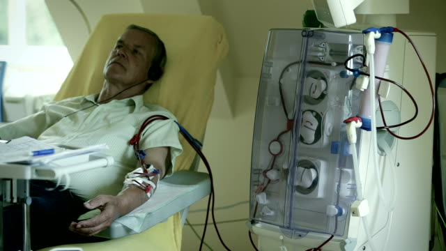 a patient during the dialysis treatment - dialysis stock videos and b-roll footage