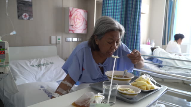 patient eating in hospital - 70 79 years stock videos and b-roll footage