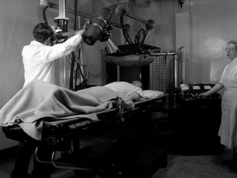 patient has an x-ray in a hospital radiology department. - x ray image stock videos & royalty-free footage