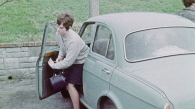 montage patient, her mother, and social worker pulling up in a car and entering psychiatric day hospital / plymouth, england, united kingdom - psychiatric hospital stock videos and b-roll footage