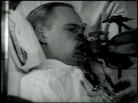 patient in bed w/ breathing apparatus in mouth expanding contracting doctor adjusting valve doctor using fluoroscope on patient patient standing in... - machine valve stock videos & royalty-free footage
