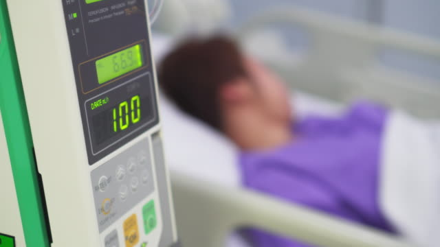 patient in hospital with saline solution volumetric infusion pump - water pump stock videos & royalty-free footage