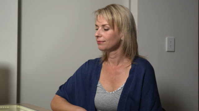 ms, patient in plastic surgeon's office holding breast implant, sydney, australia - plastic surgery stock videos and b-roll footage