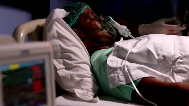 vídeos de stock, filmes e b-roll de patient lying on bed in hospital, delhi, india - condição médica