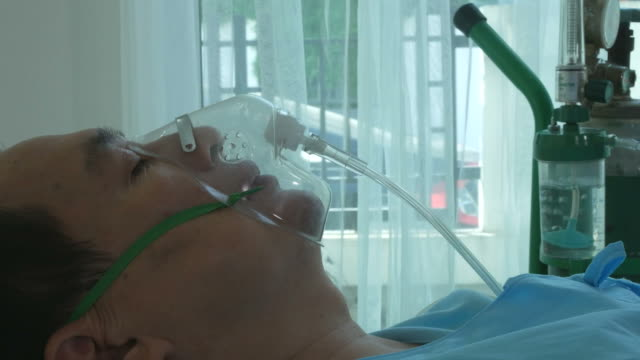 patient man be unconscious with oxygen mask - respiratory system stock videos & royalty-free footage