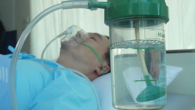 patient man be unconscious with oxygen mask - inhaling stock videos & royalty-free footage