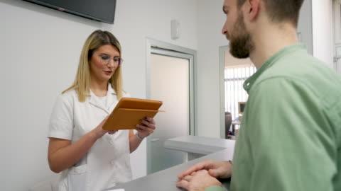 patient, nurse and hospital procedure arrangements - receptionist stock videos & royalty-free footage