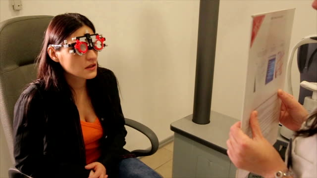 patient reads the text by an ophthalmologist - ophthalmologist stock videos and b-roll footage