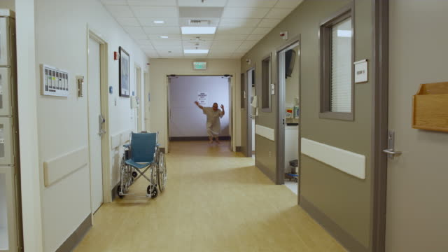 ws patient running down hallway being chased by hospital staff / edmonds, washington, usa - mental health stock videos & royalty-free footage