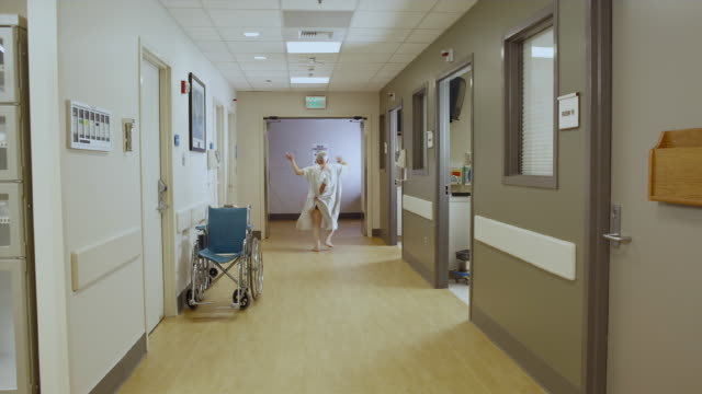 ws patient running down hallway being chased by hospital staff / edmonds, washington, usa - female nurse stock videos and b-roll footage