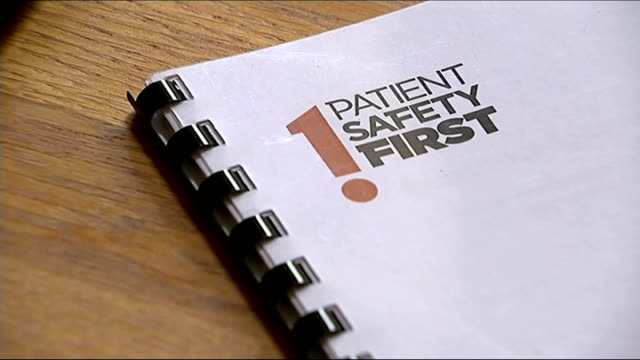 nhs patient safety system launched martin bromiley looking through paperwork close shot of 'patient safety first' document martin bromiley interview... - richard pallot stock-videos und b-roll-filmmaterial