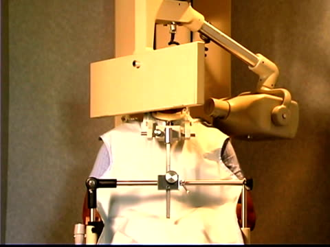 a patient sits in a panograph machine as it takes x-rays of his mouth. - one mid adult man only stock videos & royalty-free footage