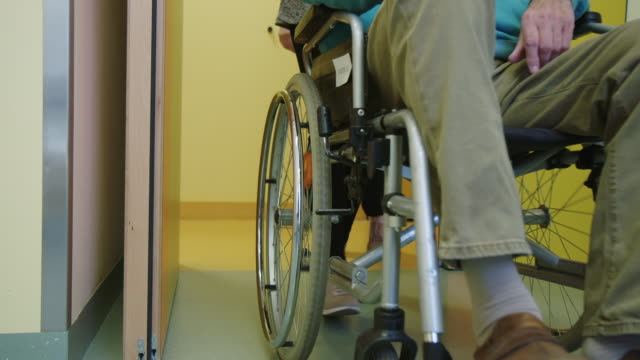 patient sitting on wheelchair at hospital - persons with disabilities stock videos & royalty-free footage