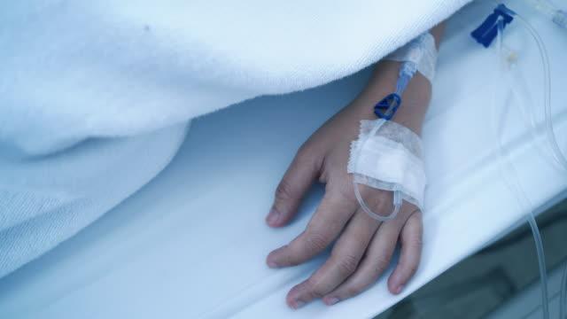 Patient sleeping in saline solution in hospital.