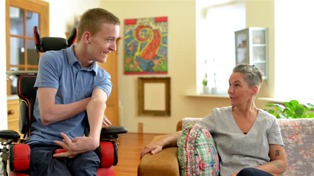 als patient son with his mother - cerebral palsy stock videos & royalty-free footage