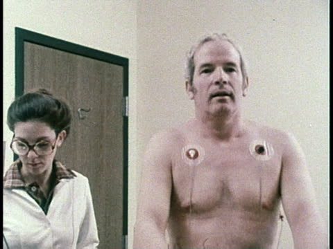 vidéos et rushes de 1979 montage patient taking stress test / united states - 1979