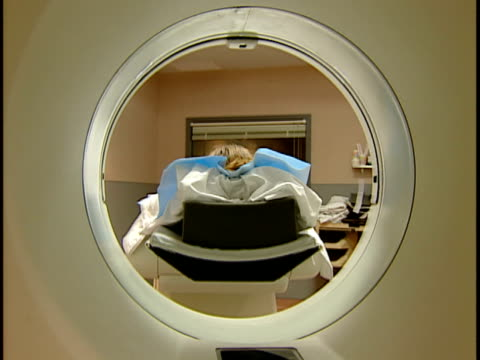 MS, Patient undergoing CAT scan, rear view