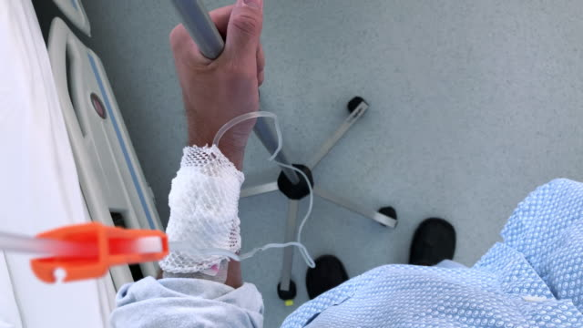pov patient with intravenous infusion holding a pole - young men stock videos & royalty-free footage