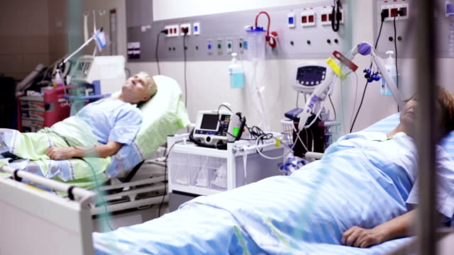 patients are llying in the post operation room - defibrillator stock videos and b-roll footage