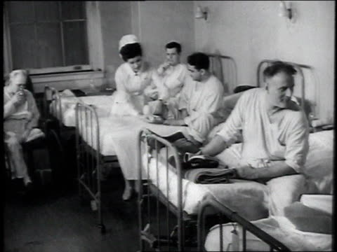 MS patients chatting in beds in a ward / United States