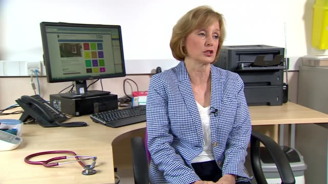 Patients forced to find new GPs as surgeries closed ENGLAND London INT Dr Rosemary Leonard interview SOT EXT Person along into GPs surgery Boarded...