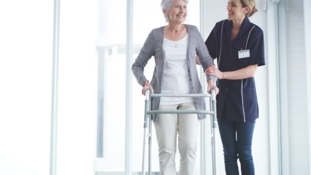 patients improve through compassion and care - walking frame stock videos & royalty-free footage