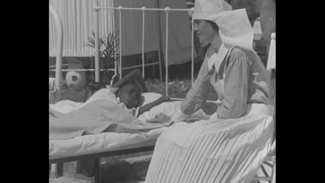 patients in beds and nurses in hospital yard / close shot of child lying in bed speaking to nurse in spanish and nurse translating child's experience... - santiago de cuba stock videos and b-roll footage