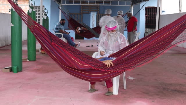 patients laying in hammocks in temporary covid-19 in manaus, amazonas state, brazil, on sunday, january 17, 2021. - temporary stock videos & royalty-free footage