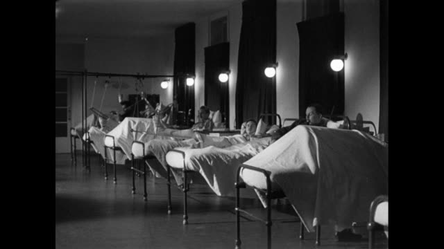 vidéos et rushes de ds patients lying in their beds at a hospital / london, england, united kingdom - world war 1