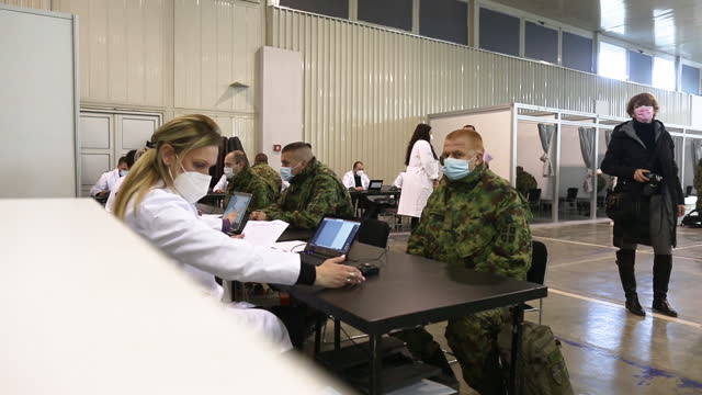 patients registering for vaccines as serbia begins sinopharm vaccination program, in belgrade, serbia on tuesday, january 19, 2021. - serbien stock-videos und b-roll-filmmaterial