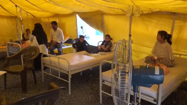 vídeos de stock, filmes e b-roll de patients suffering from cholera receive treatment at sabine hospital in the capital sanaa yemen on december 21 2017 the united nations has warned... - epidemia