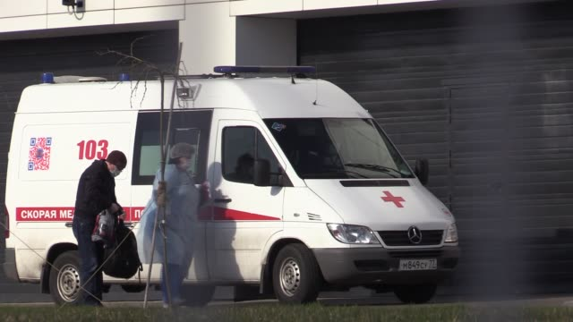 patients suspected of the coronavirus infection are brought by health officials wearing protective gear with ambulances to kommunarka hospital in... - moscow russia stock videos & royalty-free footage