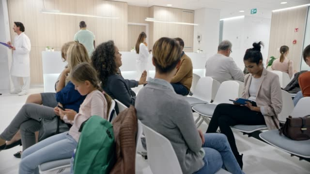 ds patients waiting in a big and modern waiting room in a hospital - sala d'attesa video stock e b–roll