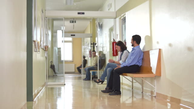 hd: patients waiting in clinic corridor - anticipation stock videos & royalty-free footage