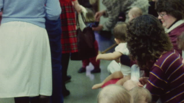 1983 montage patients waiting to see health visitor at well baby clinic / london, england - nhs stock videos & royalty-free footage