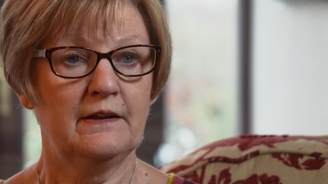 Patients with dementia taking longer to be discharged from hospital ENGLAND INT Janet Taylor interview SOT Various of Taylor looking at photographs...