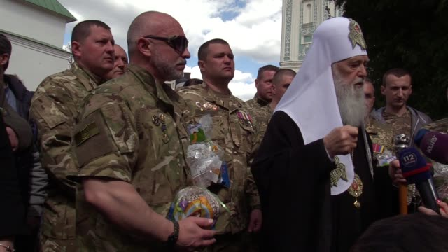 patriarch of ukrainian orthodox church of kiev patriarchy filaret blesses ukrainian servicemenwhich fighting against prorussian separatists in... - patriarchy stock videos & royalty-free footage