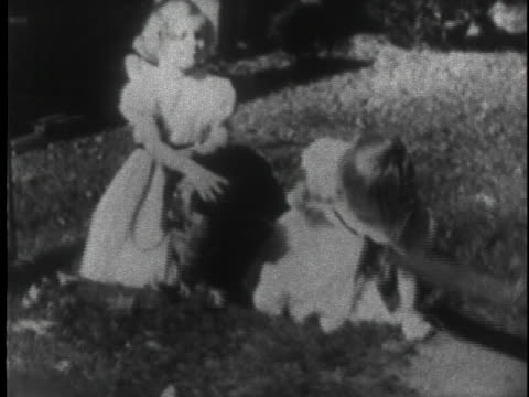 patricia and julie nixon play with their dog checkers on the lawn. - draughts stock videos & royalty-free footage