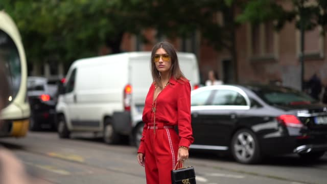 patricia manfield wears sunglasses a red low neck top flared pants a bag a necklace outside the fendi show during milan fashion week spring/summer... - spring summer collection stock videos & royalty-free footage